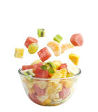 Fruits salad flies to the bowl Royalty Free Stock Photos