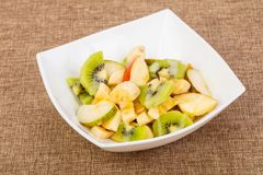 Fruits salad with kiwi. And apple royalty free stock photos