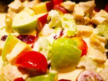 Fruits salad with mayonnaise, the ingredients are green apple, r royalty free stock photo