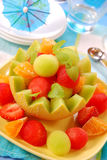 Fruits salad in melon bowl Stock Images