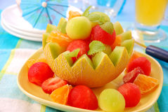 Fruits salad in melon bowl Royalty Free Stock Images