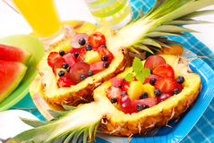 Fruits salad in pineapple. Fresh fruits salad in pineapple cut in half stock image
