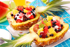 Fruits salad in pineapple. Fresh fruits salad in pineapple cut in half stock images