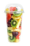 Fruits salad. In transparent glass isolated on white royalty free stock image