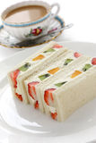 Fruits sandwich and a cup of tea Stock Photos