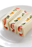 Fruits sandwich on a white plate Royalty Free Stock Photos