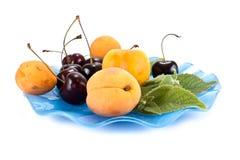 Fruits on a saucer Stock Photos