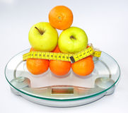Fruits on scale Stock Images