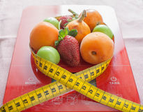 Fruits, scale and meter Royalty Free Stock Photography
