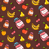 Fruits seamless pattern on a brown background Royalty Free Stock Photo