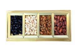Fruits secs et boîte-cadeau d'écrous Photographie stock libre de droits