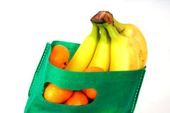 Fruits Shopping. Fruits in green shopping bag on white isolated background royalty free stock photos