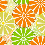 Fruits, slices of oranges, lemons and limes. Seamless pattern. Stock Images