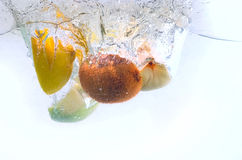 Fruits splash Stock Images