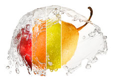 Fruits in splash of water Royalty Free Stock Photography