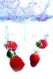 Fruits Splashing. Fresh Fruits In Water Royalty Free Stock Photography