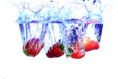 Fruits Splashing. Fresh Fruits In Water Stock Images