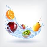 Fruits in splashing water Stock Photography
