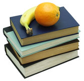 Fruits on stack of books Royalty Free Stock Photos