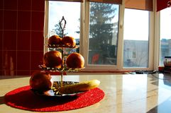 Fruits on a stand in the kitchen in the morning Royalty Free Stock Image