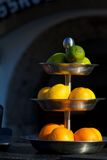 Fruits on steelplate. Oranges, limes, lemmons on steel fruit plate 3 floors Royalty Free Stock Photography