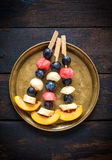 Fruits on the stick Stock Image