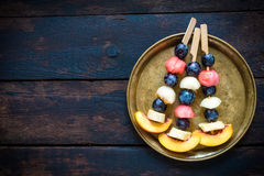 Fruits on the stick Royalty Free Stock Photography