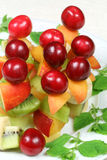 Fruits on sticks Stock Images