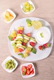 Fruits on sticks and dip Stock Image