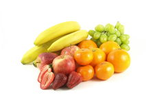 Fruits still life, isolated. Fruits variety with bananas, strawberries, apples, oranges, grapes, mandarines on white isolated background stock photos