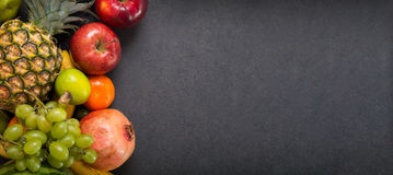 Fruits on stone countertop Royalty Free Stock Images
