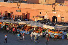 Fruits store on Djemaa El Fna at sunset Stock Images