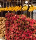 Fruits store. Selling banana longan lambutan Stock Photography