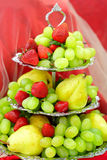 Fruits strawberries pears grapes Royalty Free Stock Photos