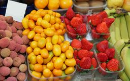 Fruits with strawberry banana litchi orange kumquat for sale to. Many types of fruits with orange kumquat  strawberry and banana litchi for sale to the market Royalty Free Stock Photography