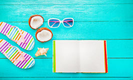 Fruits and summer accessories on blue wooden floor with copy space. Top view. Fruits and summer accessories on blue wooden floor with copy space and notebook Royalty Free Stock Photography