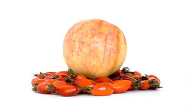Fruits of summer: hips and apple. Red hips and apple isolated on white Stock Photography