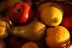 Fruits at the sunset light. A still life with fruit, banana,apple,pear. the only light source is the light of the sunset Royalty Free Stock Photos