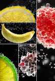 Fruits surrounded by bubbles. Fresh fruits into the soda. Photo collage on the black Stock Photography