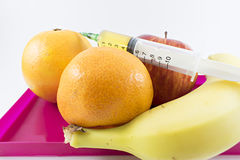 Fruits and syringe up. stock photography