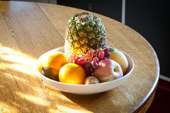 Fruits on table. The bowl of fruits is on the table with sun light falling on through the window Stock Image