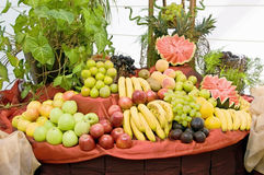 Fruits table. Table endorsed with some real fruits stock photography