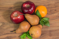 Fruits on the table. Pears, apples and orange with mint Royalty Free Stock Photo