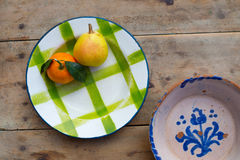Fruits tangerine and pear in vintage porcelain dish plate Royalty Free Stock Photo