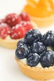 Fruits tarts. Three tarts with fresh fruits on white Stock Photos