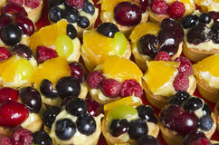 Fruits tarts. Tarts with fruits: raspberries, oranges, blueberries, cherries and grapes Royalty Free Stock Images