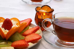 Fruits tea and candle Stock Images
