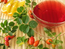 Fruits tea with rose hips and oranges Stock Image