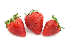 Fruits three strawberry. S over white Royalty Free Stock Image