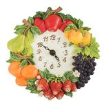 Fruits time. Clock decoratec with fruits stock photography